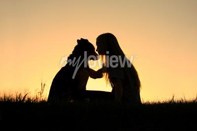 Obraz German Shepherd Dog, silhouetted against the sunsetting sky