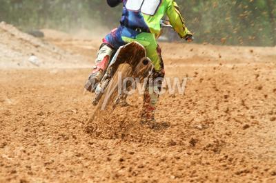 Fototapeta Dirt debris from a motocross race