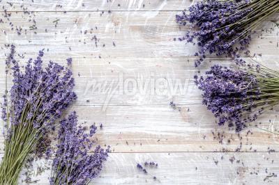 Fototapeta Dry lavander design with bouquet on wooden background top view mockup
