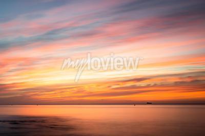 Fototapeta: sunrise over a beach in cornwall uk