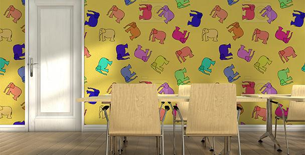 Kolorowe słonie na żółtym tle