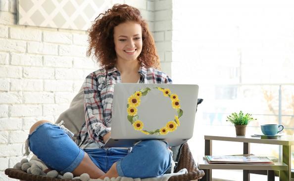 Naklejka słonecznik na laptopa